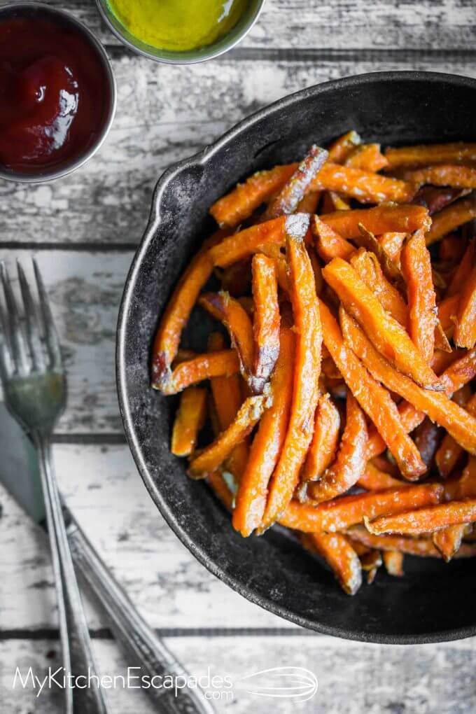 Cast iron skillet filled with baked sweet potato fries