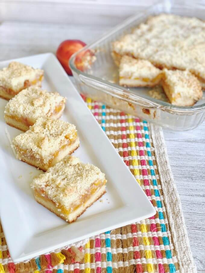 Peach crumble bars and the pan in the background