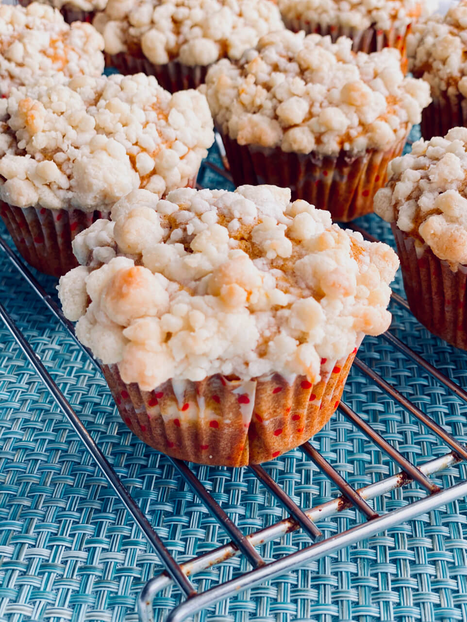 Pumpking cheesecake muffins on a wire rack